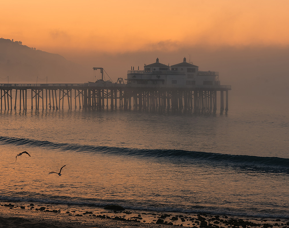 Malibu Pier at sunrise at Surfrider Beach in Malibu California