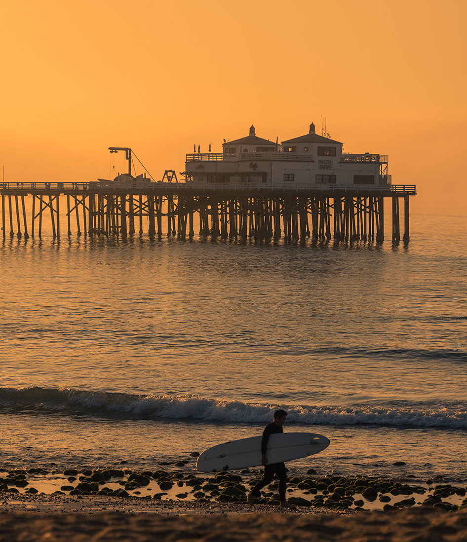 Surfer at Surfrider Beach in Malibu California at sunrise