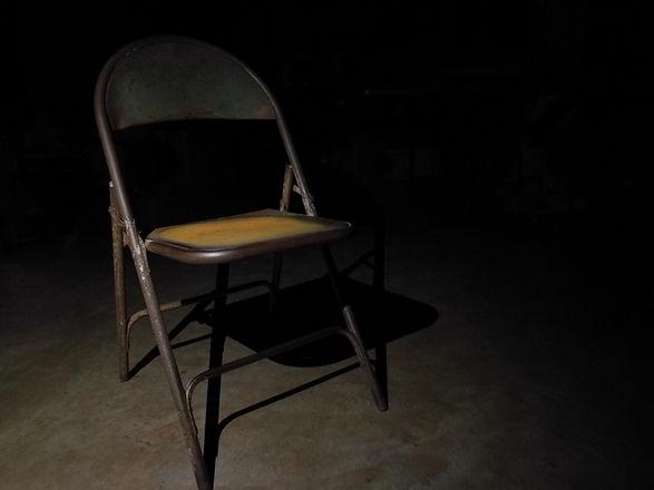 Rusty old chair in the darkest.jpg