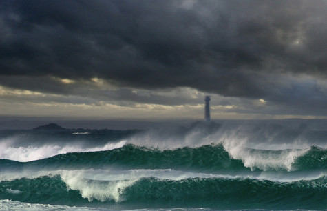 Longships lighthouse in a storm.