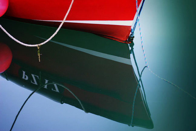 Bow reflection in Mousehole harbour.