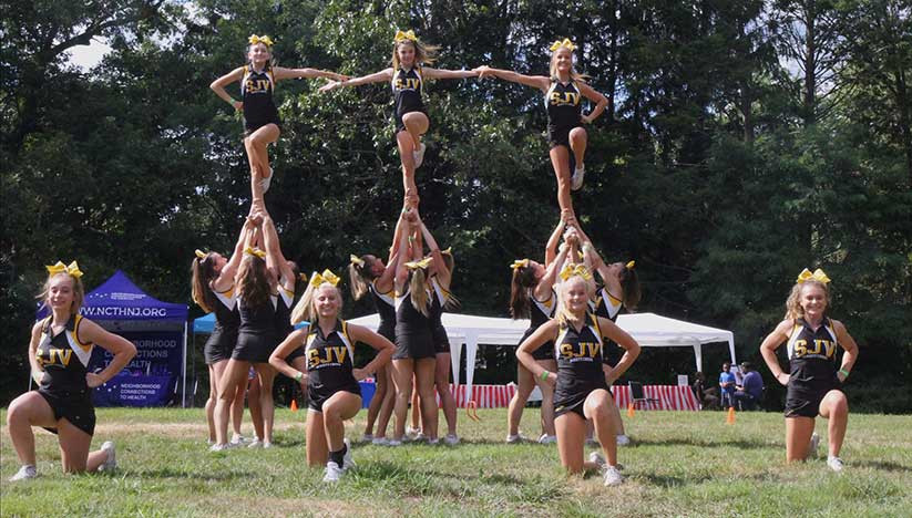 St. John Vianney High School's cheerleaders have a long history of community service, which was on display Aug. 24 at a charity event in Freehold Borough. Courtesy photo