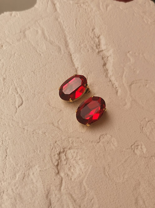 Oval red couture clip earrings