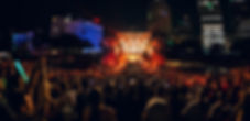 Music Fans Crowd in a music festival with fireworks and flames at Movement Festival