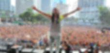 An action shot of Steve Aoki show performing
