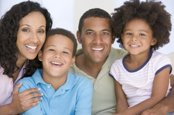 family-in-living-room-smiling-5776283