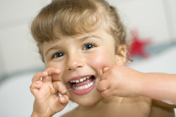 girl-cleaning-teeth-by-dental-floss-6486275