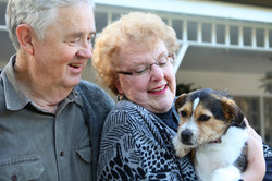 elderly-couple-with-dog-13305058