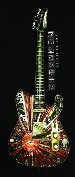 Guitarra de sucatas de ferro