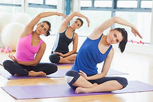 depositphotos_38464681-stock-photo-class-and-instructor-doing-stretching.jpg
