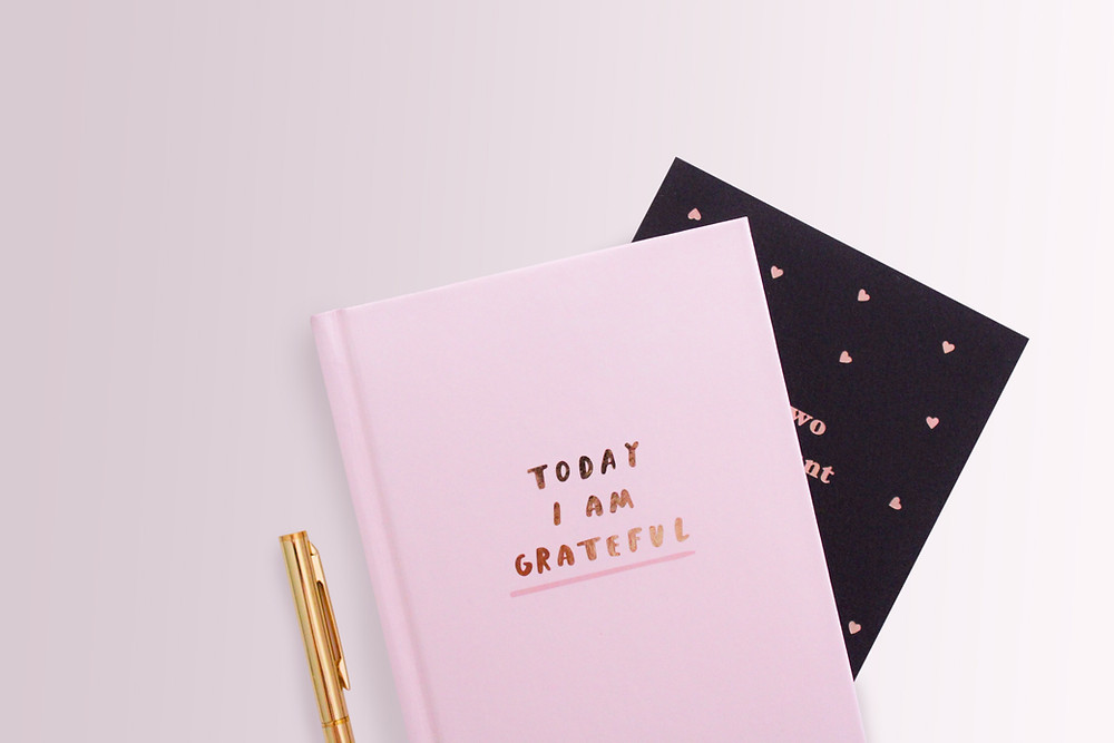 Pink gratitude journal and Peninsula Family Coaching