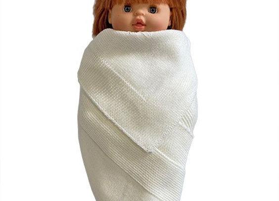 Couverture en maille pour poupée