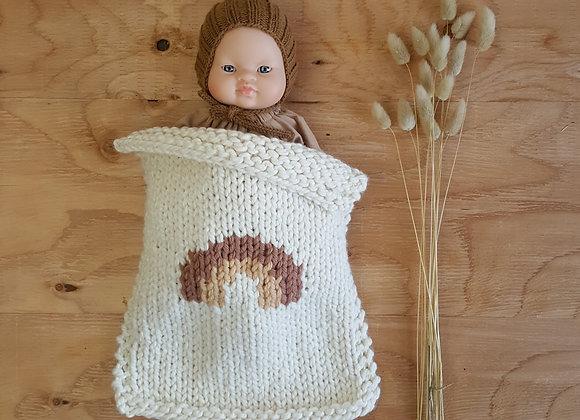 Couverture tricotée pour poupée