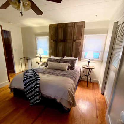 Fireside Pines Bedroom with Queen Bed with repurposed shutters as a headboard