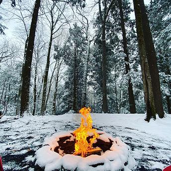 Babbling Brook Cottages snow fire pit.jp