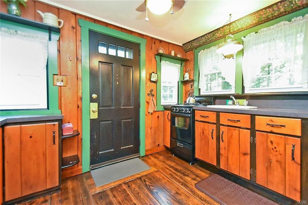 Fireside Pines full kitchen with 4 burner propane stove with oven