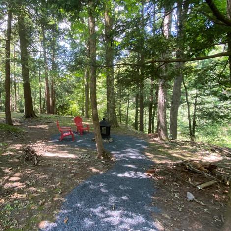"The Stargazer ""backyard"" with stone path to firepit"