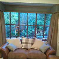 Abraham Moom wool curtains and pelmet in lounge bay window
