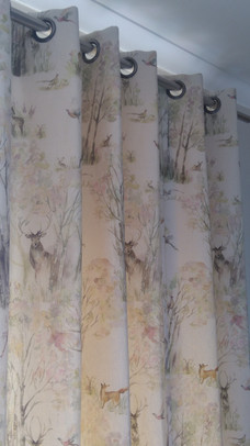 Interlined eyelet curtains in Voyage Enchanted Forest fabric