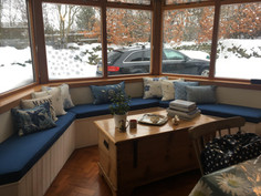 Shaped window seat cushions with scatter cushions