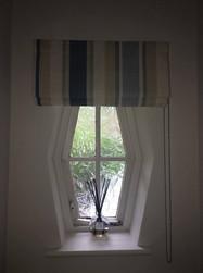 Roman blind for unusual shaped window