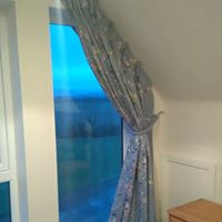 Triple pleat blackout lined curtains for sloped window