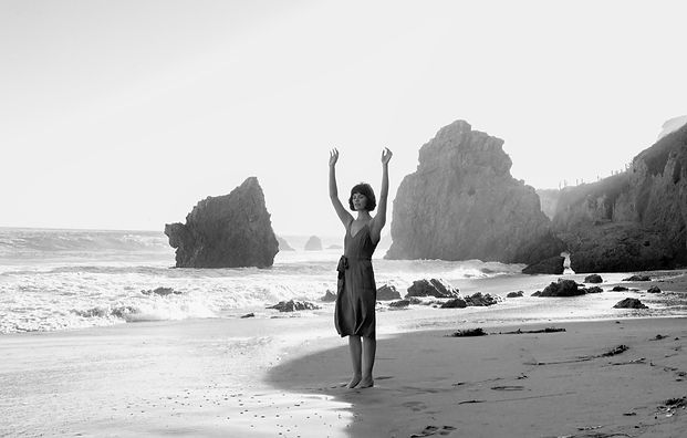 Hanna Hands up on beach BW.jpg