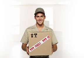 movers Toronto from We Move GTA moving company wearing a brown short sleeve shirt and a hat smiling and holding a moving box