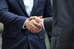 handshake-of-two-men-in-business-suits-p