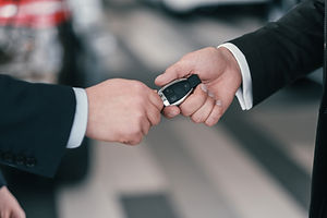 giving-a-key-from-new-car-at-dealership-