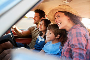 family-relaxing-in-car-during-road-trip-