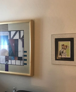 Framed pet portrait by Fiona Purdy hanging in a home