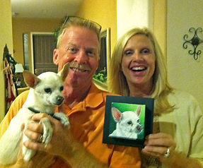 Clients with painted pet portrait