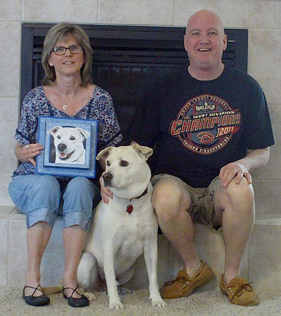 White Dog with framed painted portrait