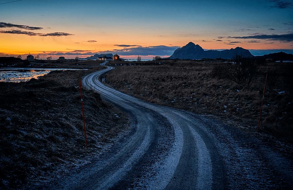 A long road and a sunset. Photo by Vidar Nordli-Mathisen (@vidarnm) on Unsplash.