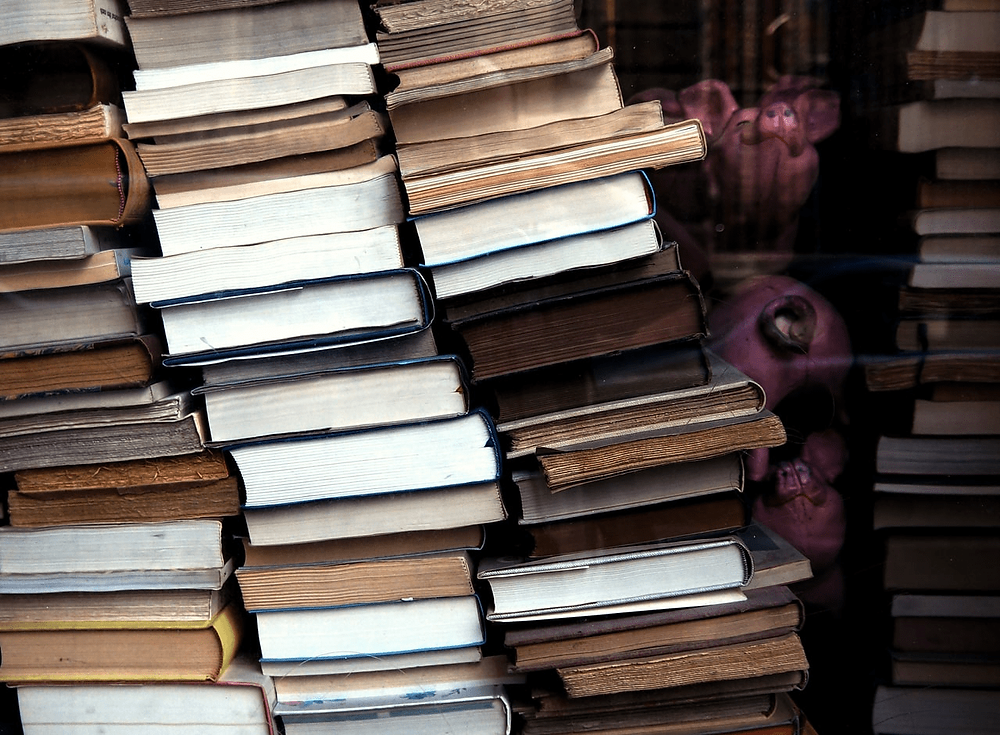 Photo of stacked books by All Bong (@all_bong) on Unsplash.