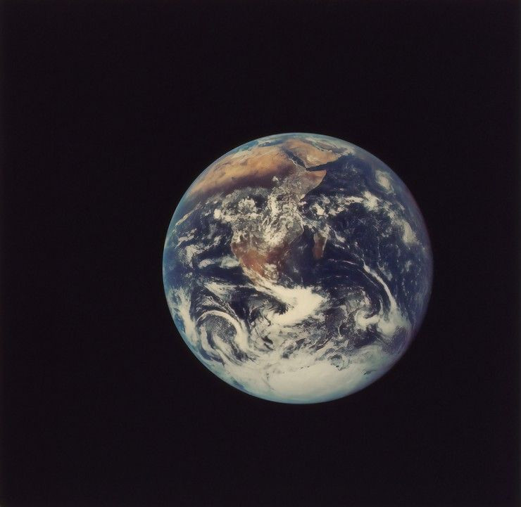 The Earth is pictured from space with a black background.