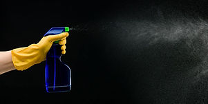 Drop The Mop Domestic and Cleaning Services - Cleaning Spray bottle spraying with rubber gloves