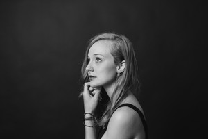 black and white, profile of young blonde girl staring up at the ceiling