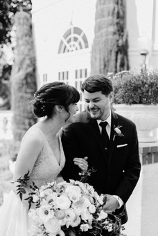 black and white, newly married couple walking by fountain at Vizcaya Sacramento