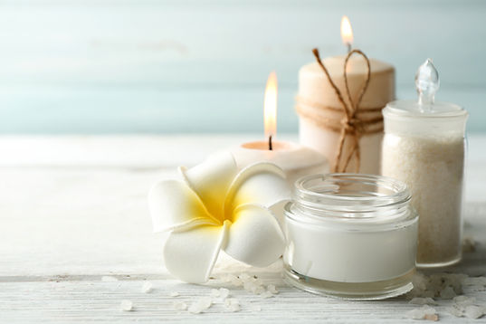 Spa coconut products on light wooden bac