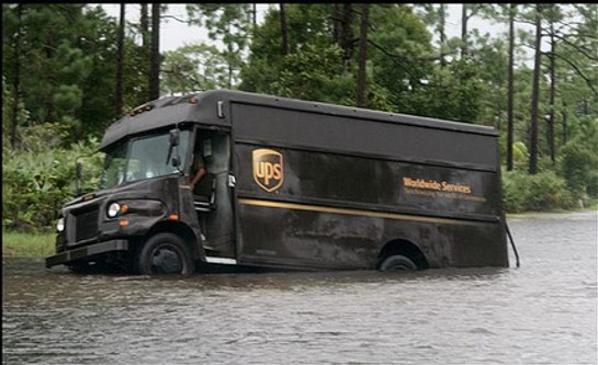 Ups truck sinking in a lake in the woods
