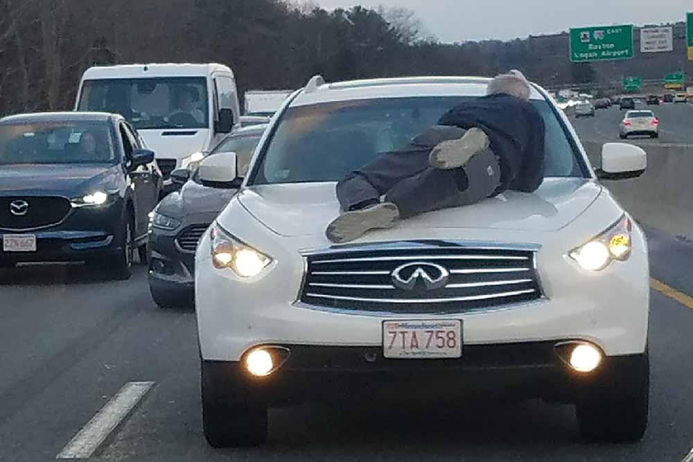 Stressful Day for Man on Hood of Car