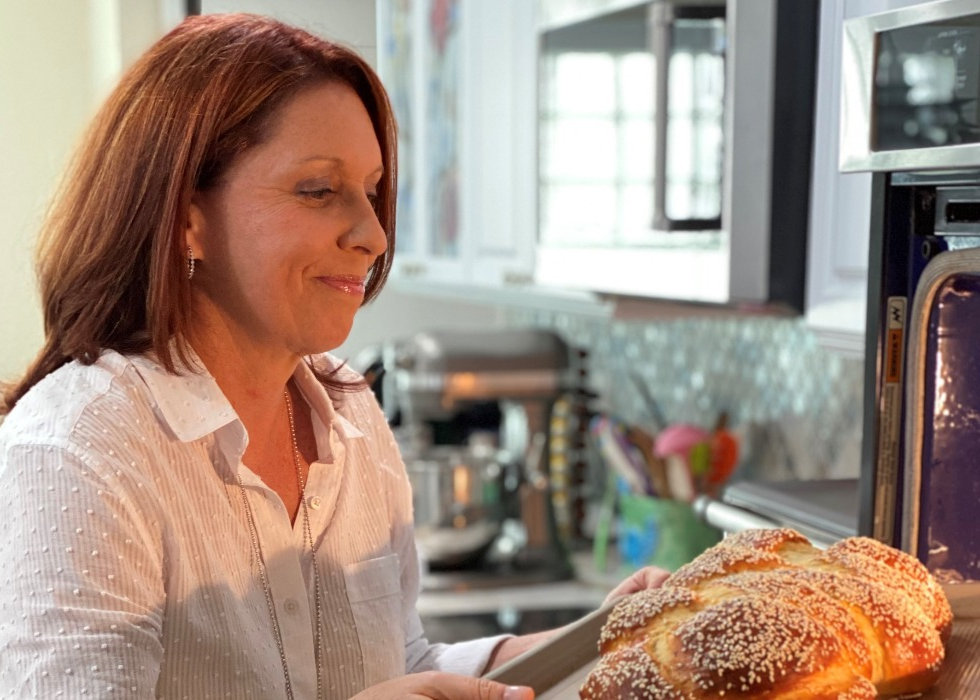 Shari taking challah out of the oven_edited.jpg