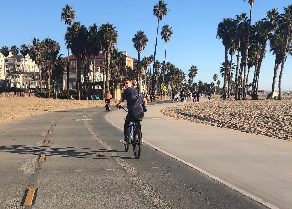 My son riding along the Venice Beach boardwalk bike path.