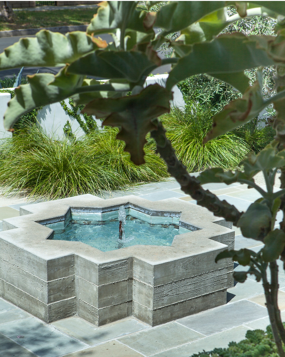 A Spanish Bungalow's Sophisticated Garden Fountain