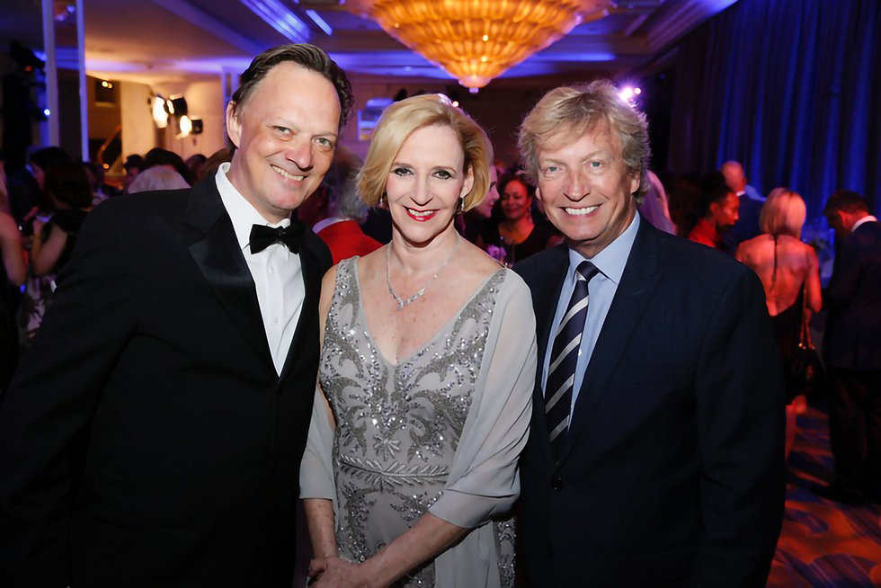 Artistic Director Thordal Christensen with members at an event