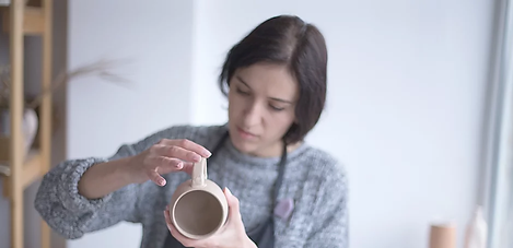 Female Potter Making Mug.webp