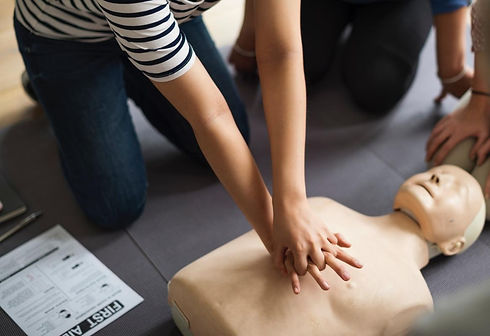 Woman in striped short sleve shirt performing CPR