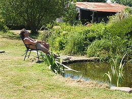 naturist camping camp site nudist accommodation also naturist spa lakeside location near skegness lincolnshire uk  lakeside farm like clover spa nudist naturist spa and  tythingbarn  Acorns Naturist Retreat or Naturist Accommodation at Pevors Farm
